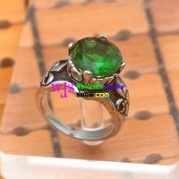 luxurious stainless steel ring with a large green gem vintage jewelry