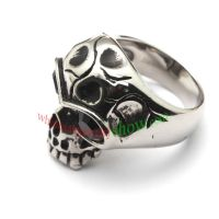 a skull ring with blue man-made jewel & made of stainless steel