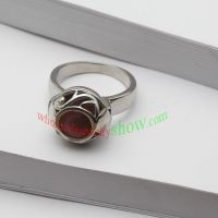 Classical ring with red man-made jewel made of stainless steel