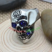 The skeleton ring with blue eyes made of stainless steel