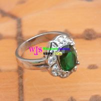 stainless silver ring with a green gems in its heart stone ring