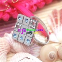 stainless steel wedding ring with a shining Rubik's Cub stones in its heart.