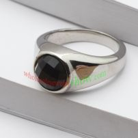 The ring with black man-made jewel & made of stainless steel