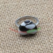White and black pebble head with shiny silver ring