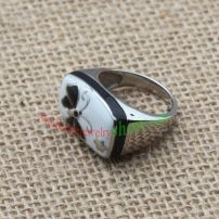Pebble with butter fly printed head ,shiny silver ring